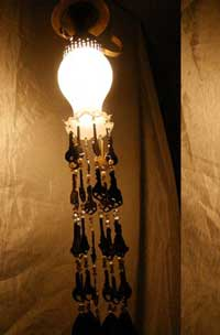A lampshade decorated with keys.