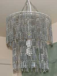 A lampshade made from jumbo paperclips.
