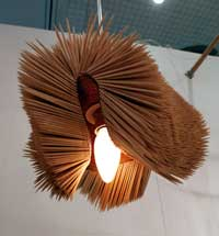 A flexible lampshade made from toothpicks.