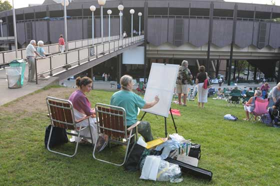 An artist paints on the lawn at SPAC before a performance of the Philadelphia Orchestra last August (Photo by Andrzej Pilarczyk)