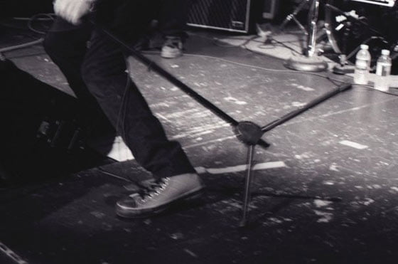 Tim Livingston of the Last Conspirators in Converse Chuck Taylor's quilted high-tops at Jason's Upstairs Bar in Hudson (photo by Bill Dhalle)