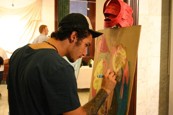Josh Boyark of Existing Artists works on a painting