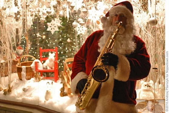 A saxaphone-playing Santa at the Troy Victorian Streetwalk