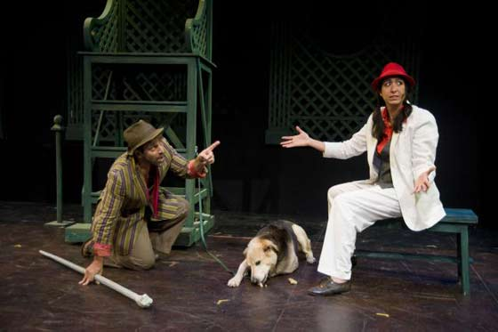 The two gentlemen's servants, Launce (Anthony Perullo) and Speed (Eleni Sophia), discuss Launce's dog, Crab (Guardian Winkles, center) (photo: Kevin Sprague)