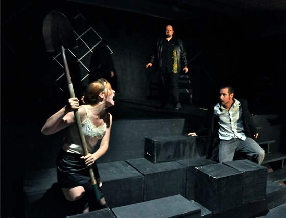 Hamlet (Chelsea LeSage) and Laertes (Jesse lee Egan Poirier) first come to blows over Ophelia's grave, as Claudius (Curtis Elfenbein Asch) looks on (photo: Jess Pillmore)