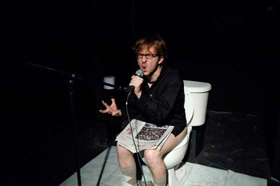The Actor Playing Bill Viola (Josh Sauerman) explains his toilet troubles to the audience