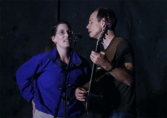 David Wilcox singing a duet with a fan
