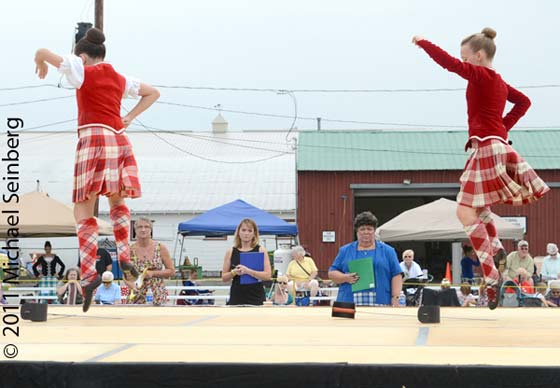 The judges look on as two young dancers perform during the Highland Dance competition.