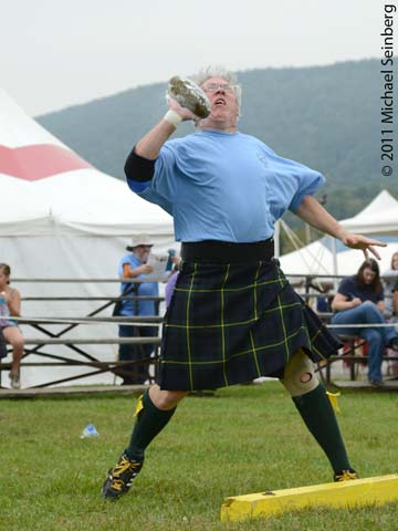 A competitor winds up during the stone throw event of the Highland Games athletic competition.