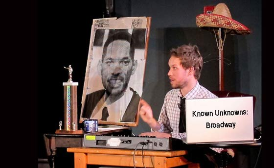 "Ben Elliott, host of ""Known Unknowns."" the pub quiz game night prepares for the next show on Saturday, November 26 at 8 pm at New Stage Performing Arts Center."