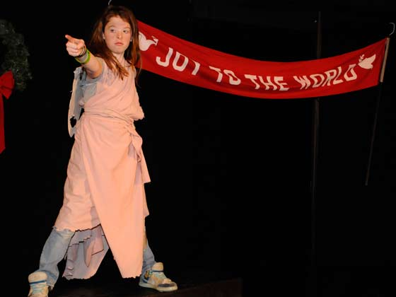 "Gladys Herdman, as the Angel of the Lord, (Grace Kelley) tells the shepherds ""Unto you a Child is Born"" in ""The Best Christmas Pageant Ever"" at New Stage Performing Arts Center. (photo: Peggy Reeves)"