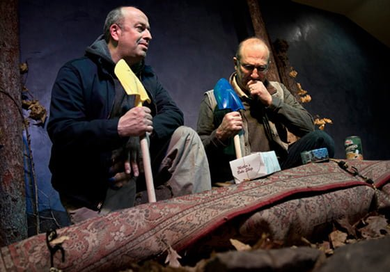 Rob (Rob Leo Roy) and Eddie (Eddie Allen) contemplate the task of burying the Persian rug containing Eddie's mother with the colorful sand shovels they have brought along. (photo: Dan Region)