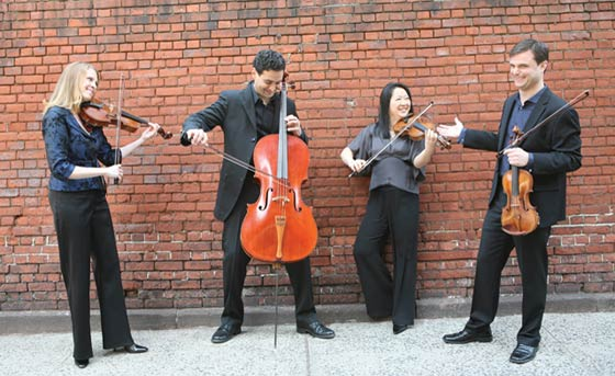 The Daedalus Quartet from left to right: Jessica Thompson, viola; Raman Ramakrishnan, cello; Min-Young Kim, violin; Ara Gregorian, violin (photo by Janette Beckman)