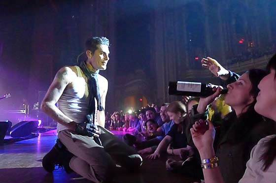 Perry Farrell passes the bottle (photo by Kirsten Ferguson)