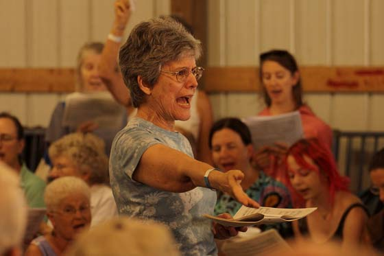 Mary Alice Amidon leads a sacred harp sing in the Sheep Barn
