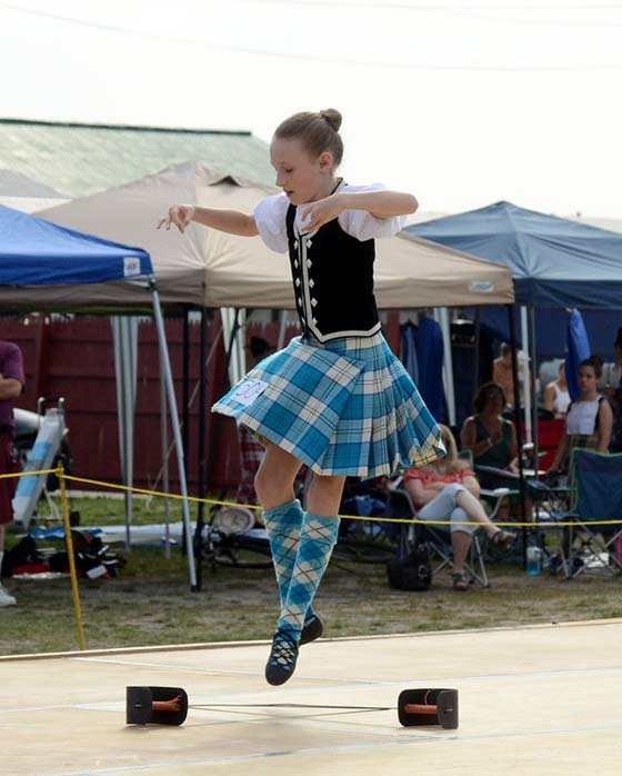 A young girl performs the sword dance during Saturday's dance competition.