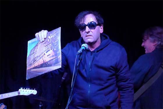 Dave Weckerman with a Phil Manzanera album (photo by Kirsten Ferguson)