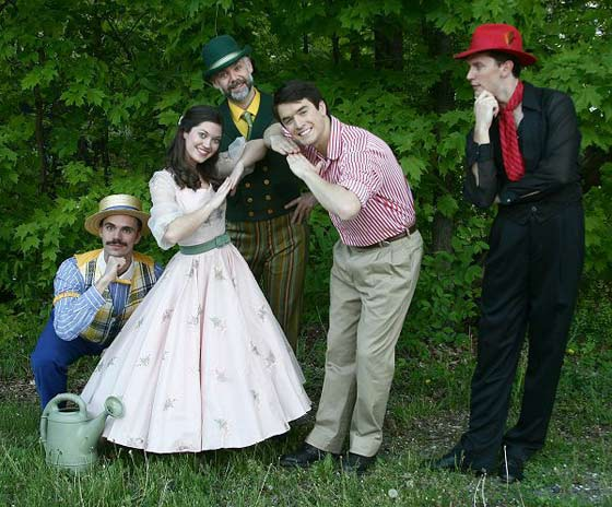 Showing their new-found togetherness is struck by Bellomy (Derrick Jaques), Luisa (Stephanie Granade), Matt (Andrew McMath), and Hucklebee (Gabe Bleyeu) in The Fantasticks. Even as they celebrate newfound happiness, El Gallo (Patrick Heffernan) wonders how long they will stay that way.