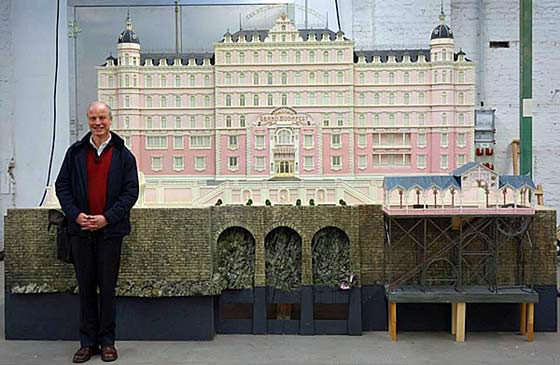 Carl Sprague with the model of the Grand Budapest Hotel he drew/designed for the film.