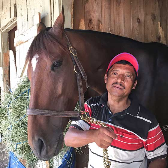 Groom and stable assistant Sixto with 2014 Whitney winner Moreno before this year's Whitney.  Moreno was retired following the Whitney.
