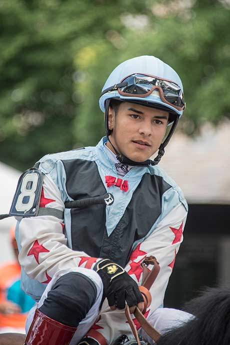 Apprentice jockey phenom Eric Cancel heading to the track from the walking ring to the track.  Cancel had 10 winners through 8/27/2015, in 10th place of the jockey standings for winners.