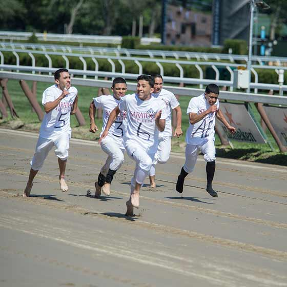 The jockey footrace was won by Angel Cruz, who easily bested the field of jockeys running barefoot from the starting gate on the main track, 8/1/2015.