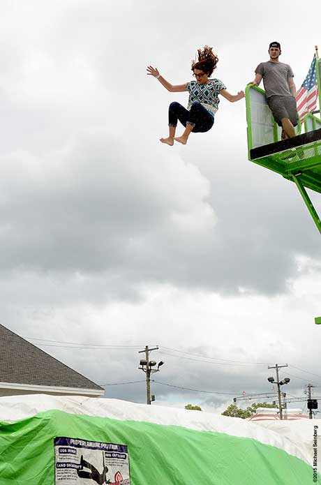 A young fair-goer tries out a Hollywood stunt jump.