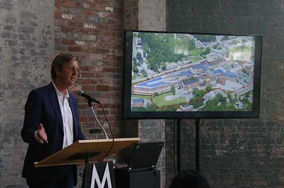 Executive Director Joe Thompson gives an overview of the newly remodeled Building 6 (photo: Sara Ayers)