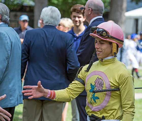 Jockey Junior Ortiz reaching out to shake Lady Ivanka owner's hand, 8/9/2017.