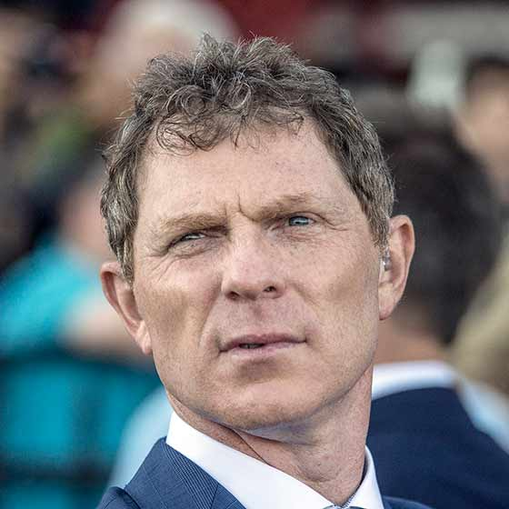 Bobby Flay watching the race down close from the winner's circle, 8/5/2017.